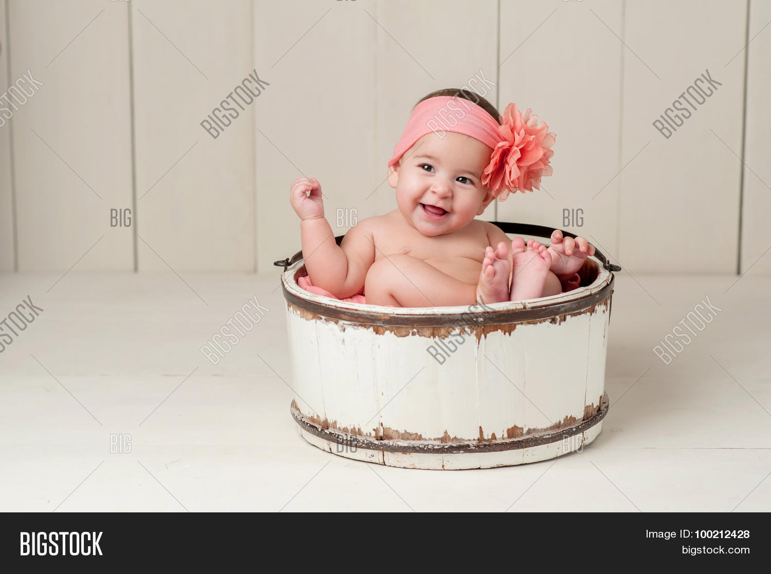5-6,6,6-7,adorable,alert,baby,beige,bucket,cheerful,colored,cream,cute,fashioned,female,flower,girl,happy,headband,human,infant,innocence,innocent,joy,joyful,laugh,laughing,month,old,old-fashioned,one,paneling,peach,person,portrait,sit,sitting,six,smile,smiling,vintage,white,wood,wooden