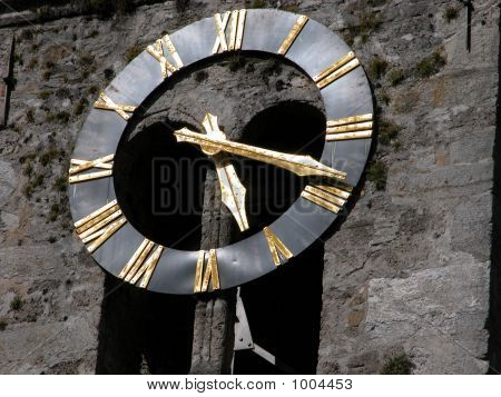 a view of the clock on the steeple of the main church in wildereswil switzerland stock photo