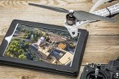 ramble flying photography idea - exploring airborne picture of grain lifts on an advanced tablet