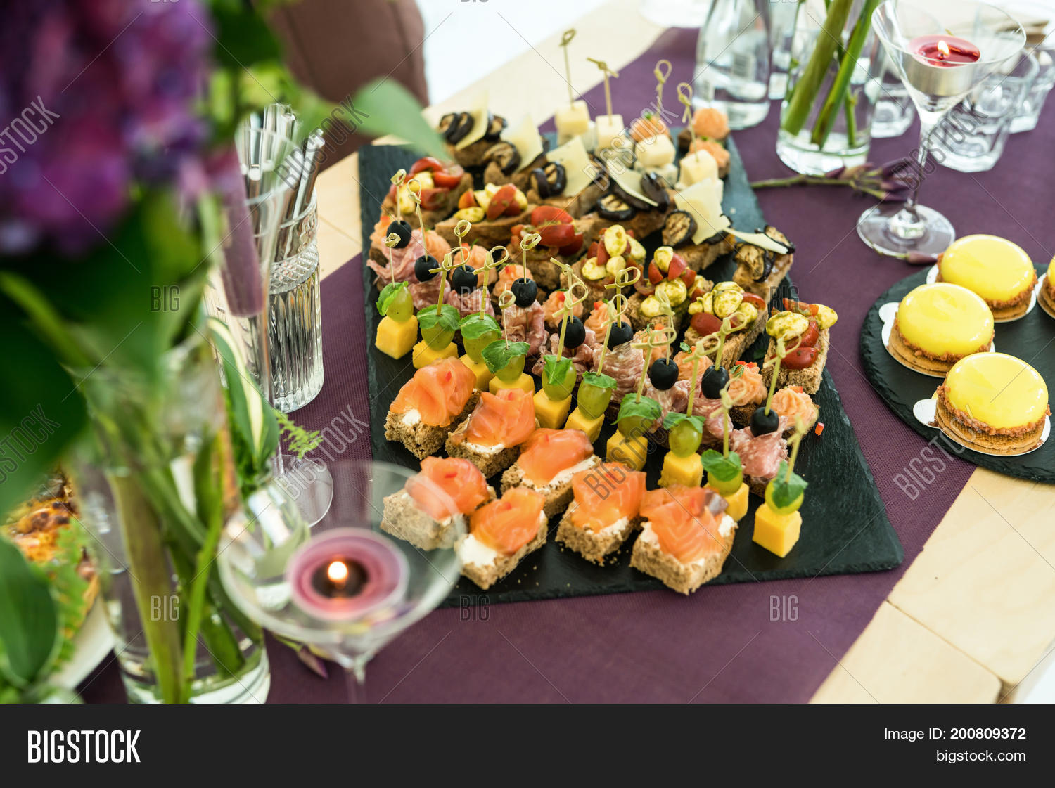 appetite,appetizer,banquet,birthday,black,brunch,buffet,cake,canape,candle,cater,catered,catering,cuisine,decoration,delicious,dinner,event,festive,flowers,food,holiday,hotel,lunch,luxury,meal,party,prepared,purple,restaurant,service,set,shale,table,tasty,violet,wedding