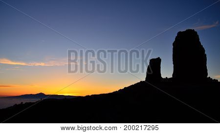 Vibrant sunset with intense blue sky, Roque Nublo and the frog, Canary islands stock photo