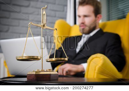 Weight scale of justice lawyer in background. lawyer document agreement attorney scales authority background balance concept stock photo