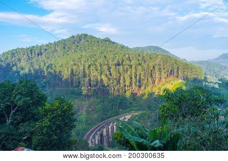 The beautiful Nine Arches Bridge in the main landmark located in valley next to town Demodara Sri Lanka stock photo