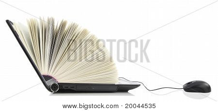 Laptop as a Book connected to a computer mouse stock photo
