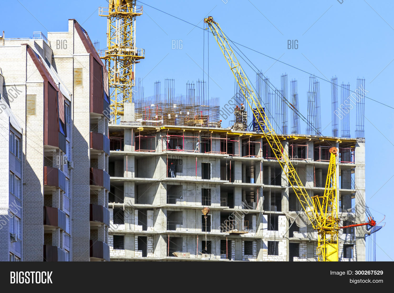 apartment,architecture,balcony,beam,blue,brick,building,casing,cast,cement,city,concrete,condo,construction,crane,deck,decking,developer,development,equipment,estate,flat,high,housing,industrial,industry,mixed,modern,mortgage,multi,project,property,real,rebar,residence,residential,rise,roof,scaffolding,site,sky,steel,storey,tall,tower,unfinished,urban,window,work,yellow