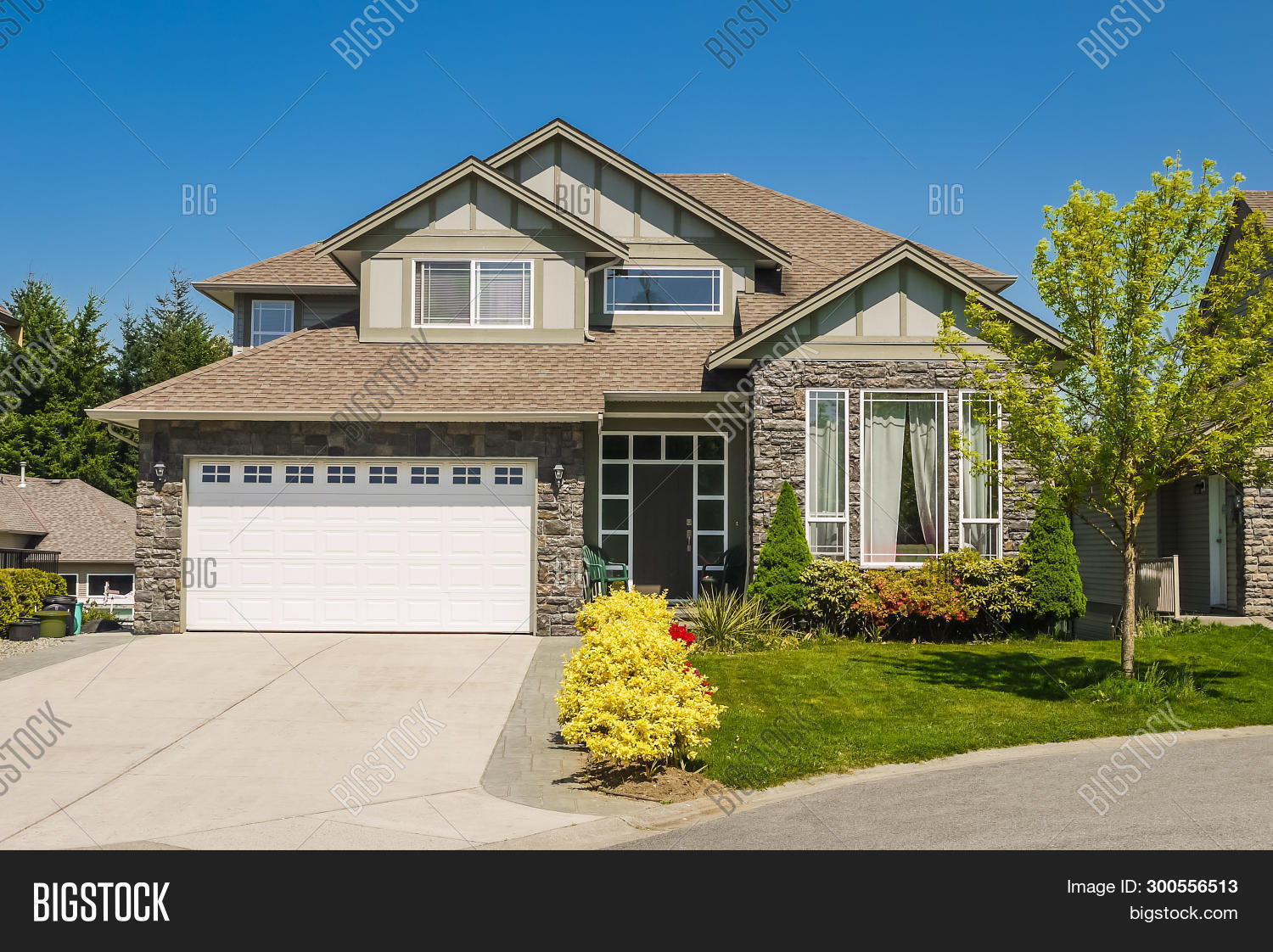 Big Family House With Concrete Driveway To Double Size Garage. Residential House Entrance With Lands