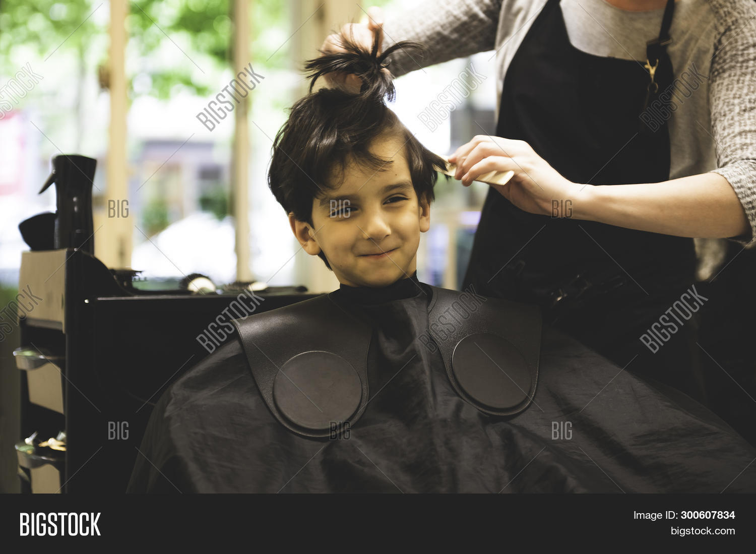 background,barber,barbershop,boy,child,childhood,client,customer,cut,cute,eyes,face,fashion,female,fun,hair,haircut,haircutting,hairdresser,hairdressing,hairstyle,hand,handsome,happy,head,kid,lifestyle,little,model,no,people,portrait,professional,real,salon,scissor,shop,sitting,smile,smiling,style,styling,stylist,trim,woman,young,youth