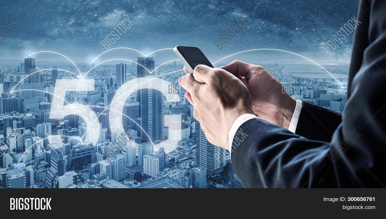 5g,background,blockchain,blue,broadcast,business,businessman,cellular,city,cityscape,cloud,communication,concept,connect,connected,connection,connectivity,data,device,digital,e-business,e-commerce,future,futuristic,global,gps,internet,iot,media,mobile,modern,network,networking,new,of,online,phone,signal,skyline,skyscraper,smart,smartphone,speed,technology,telecommunication,things,urban,using,wifi,wireless