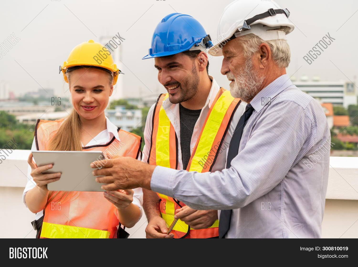 architect,blueprint,building,business,businessman,businesswoman,busy,computer,construction,constructor,contractor,cooperation,design,document,engineer,engineering,expertise,foreman,group,happy,hard,hardhat,hat,helmet,house,industry,laptop,man,manager,meeting,men,occupation,outdoors,paperwork,people,plan,professional,project,safety,site,tablet,team,teamwork,woman,women,work,worker,working,young