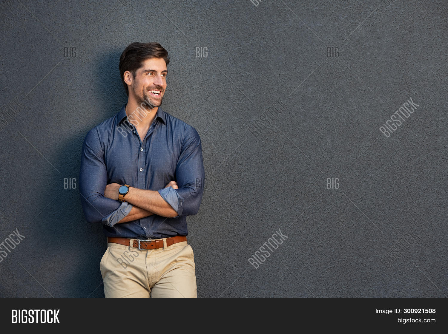 Happy successful businessman in smart casual looking away. Portrait of satisfied business man with c
