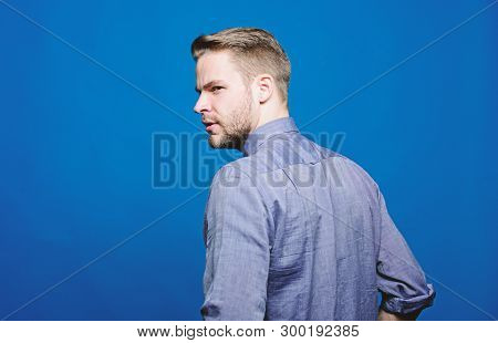 Barber and beard care. Beard grooming salon. Barber salon. Beard grooming. Get ready for date. Hipster denim shirt looks attractive blue background. Man well groomed beard. Well groomed macho stock photo