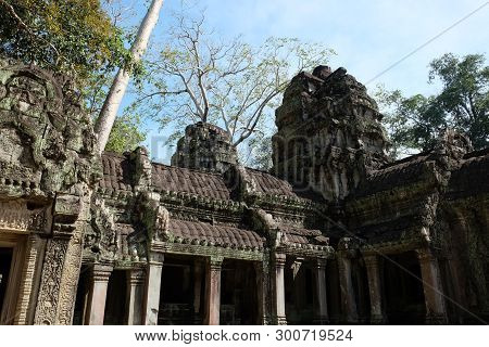 Ruins of an ancient Khmer building. Stone house decorated with magnificent carvings. Monument of architectural art of medieval Asia. stock photo