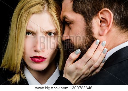 Woman touches man's face. Romantic relationships. Couple in love. Loving girl with makeup touch man beard. Woman touching face of handsome man. Girlfriend touches face of boyfriend. Intimacy concept. stock photo