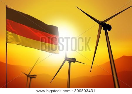 Germany wind energy, alternative energy environment concept with turbines and flag on sunset - alternative renewable energy - industrial illustration, 3D illustration stock photo
