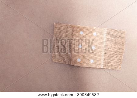 Medical Adhesive plaster on a person's back on a wound. stock photo