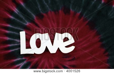 The word love and red and blue tie dye stock photo