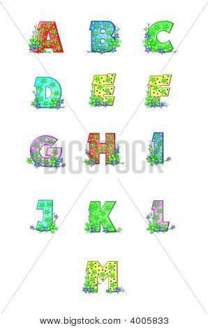 Alphabet letters A to M are decorated with yellow dots. Flowers and grass decorate each letter stock photo
