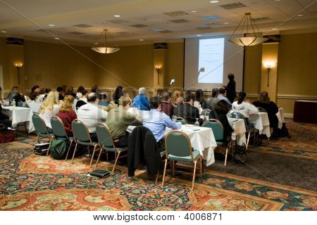 Hotel conference room full of people participating in the business training. stock photo