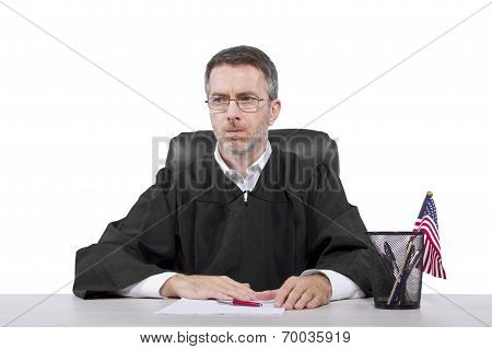 middle aged caucasian american judge in a robe sitting stock photo