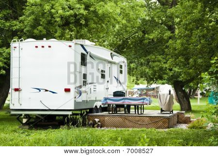 Fifth Wheel camping trailers parked in a recreational vehicle campground stock photo