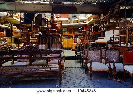Antique furniture shop in the flea market in the Monastiraki area in Plaka, Athens. stock photo