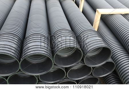 warehouse of the corrugated pipes of plastic for laying an optical fiber at the construction site stock photo