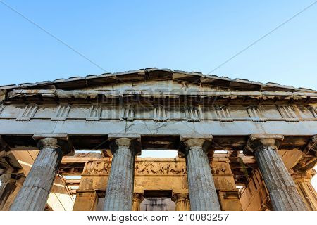 Athens Greece. Hephaestus temple in ancient Agora on blue sky background stock photo