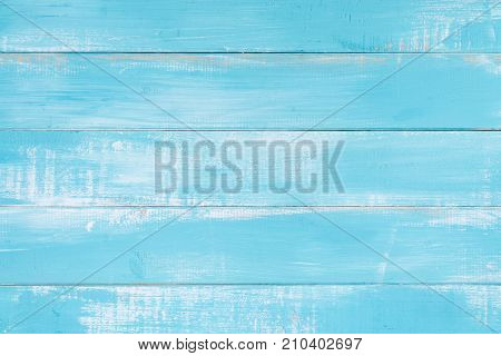 Blue wood texture background surface with old natural pattern or old wood texture table top view. Grunge surface with wood texture background. Vintage timber texture background. Rustic table top view.