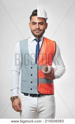 Handsome young man wearing smart casual business outfit and safety vest with a hardhat carrying a blueprint profession occupation job career architecture constructionist success CEO. stock photo