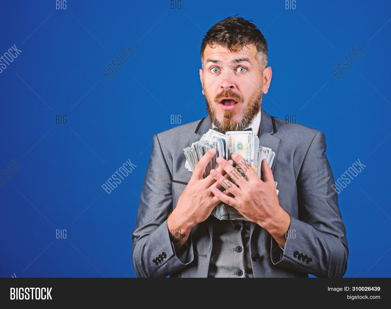 Cash transaction business. Man happy winner rich hold pile of dollar banknotes blue background. Win lottery concept. Easy cash loans. Businessman got cash money. Get cash easy and quickly