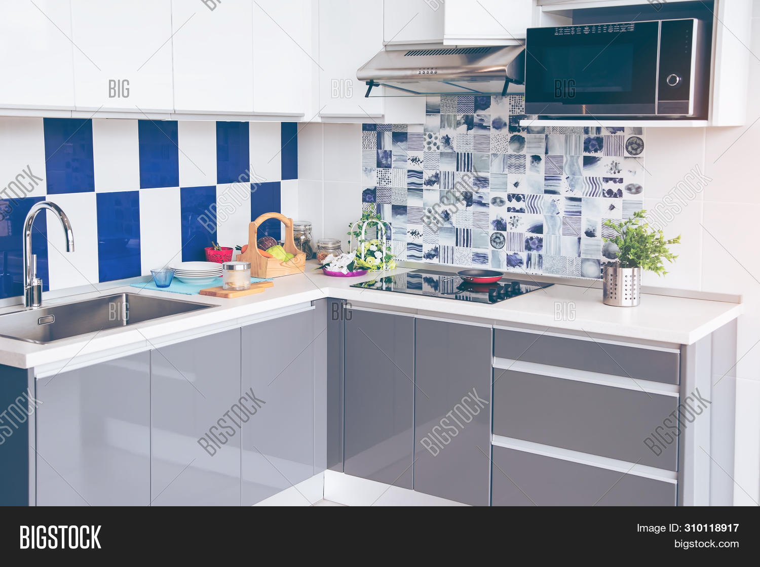apartment,appliance,architecture,background,black,built,cabinets,ceramic,contemporary,cook,cooker,cooking,cooktop,cookware,counter,decor,design,dining,electric,equipment,floor,food,furnished,furniture,glass,granite,hob,home,hot,house,household,induction,interior,kitchen,lifestyle,luxury,metal,modern,new,object,pan,quartz,room,stainless,steel,stove,technology,top,wall,white