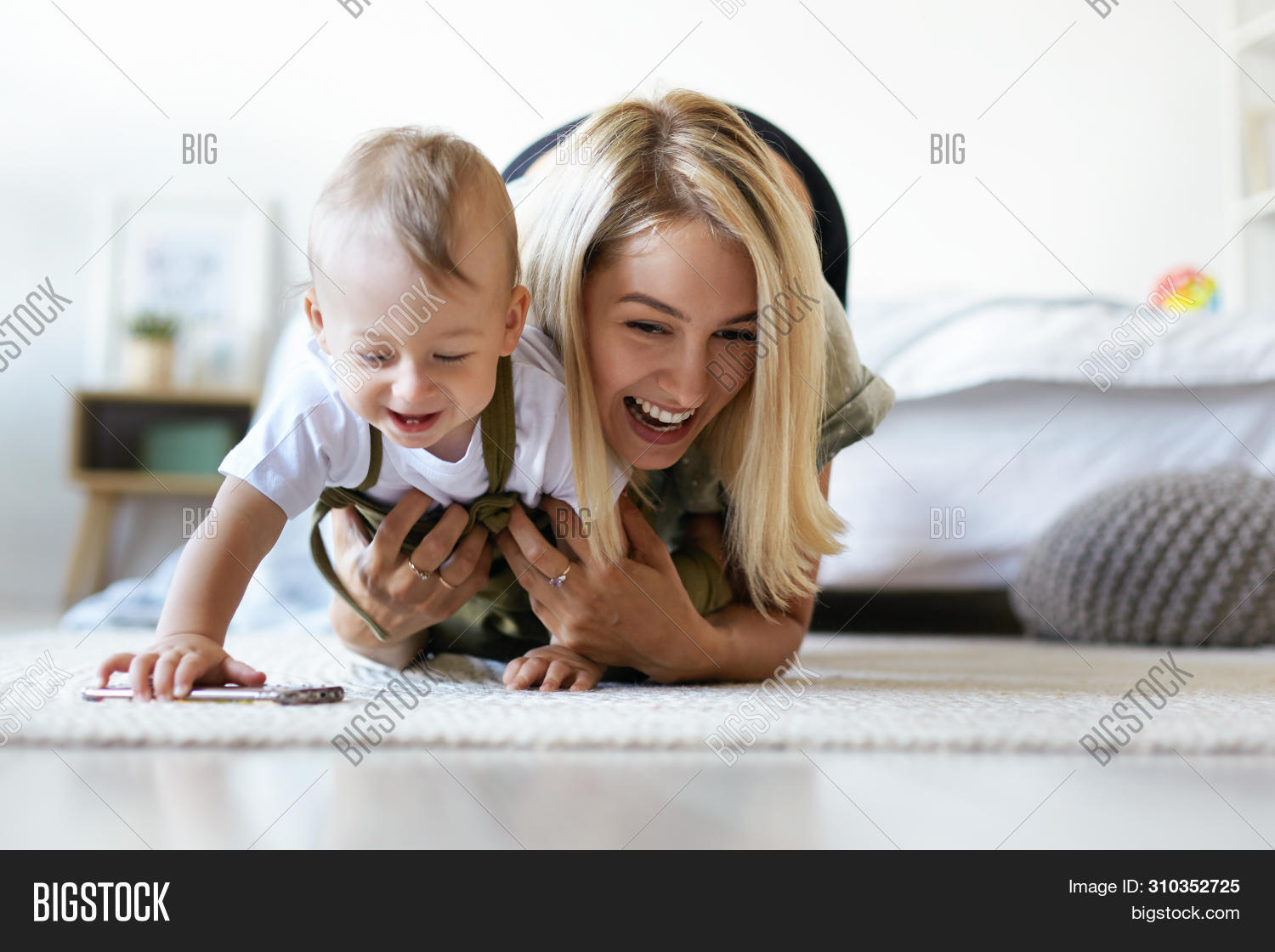 adult,baby,beautiful,care,casual,caucasian,cheerful,child,childhood,cute,daughter,family,female,floor,fun,girl,happiness,happy,healthy,home,house,indoor,infant,interior,joy,kid,laughing,leisure,lifestyle,little,love,mom,mother,motherhood,parent,parenthood,people,playful,playing,pretty,small,smiling,son,toddler,together,two,white,woman,young