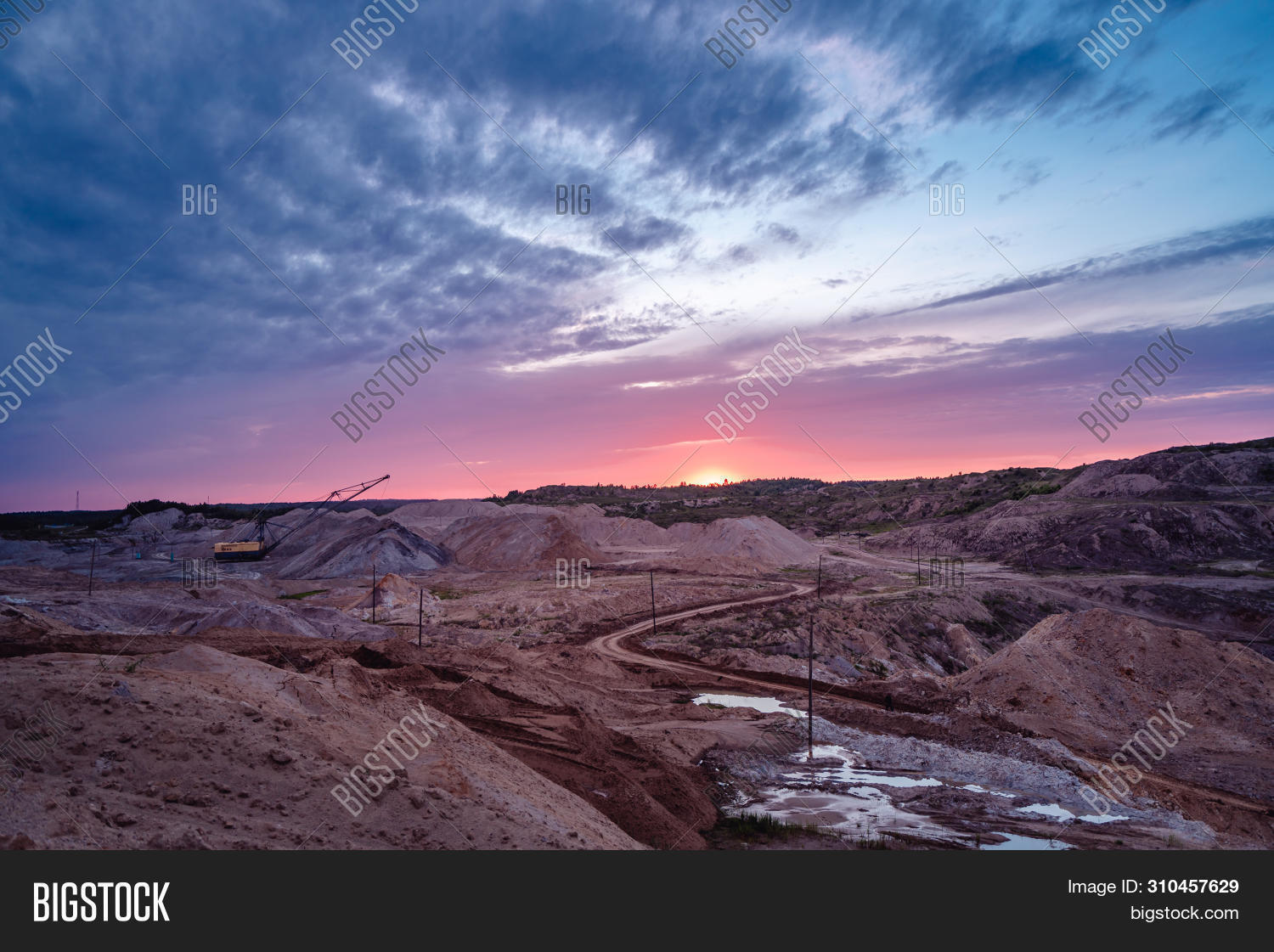 Coal Mining At An Open Pit At Sunset