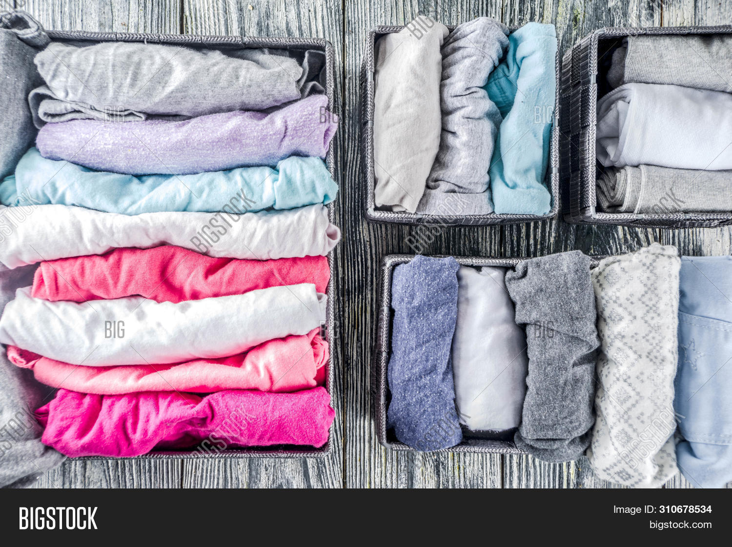 House Cleaning Concept. Vertical Tidying Up Storage. Marie Kondo Tidying Method. Neatly Folded Cloth