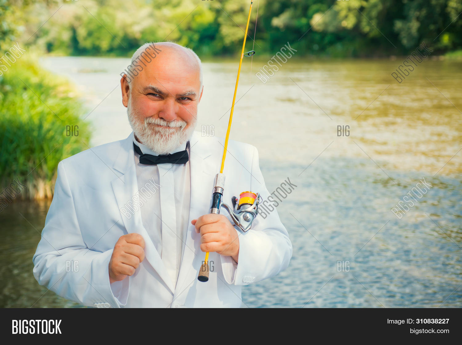 Fly Fishing For Trout. Brown Trout Being Caught In Fishing Net. Portrait Of Cheerful Man Fishing. Fl