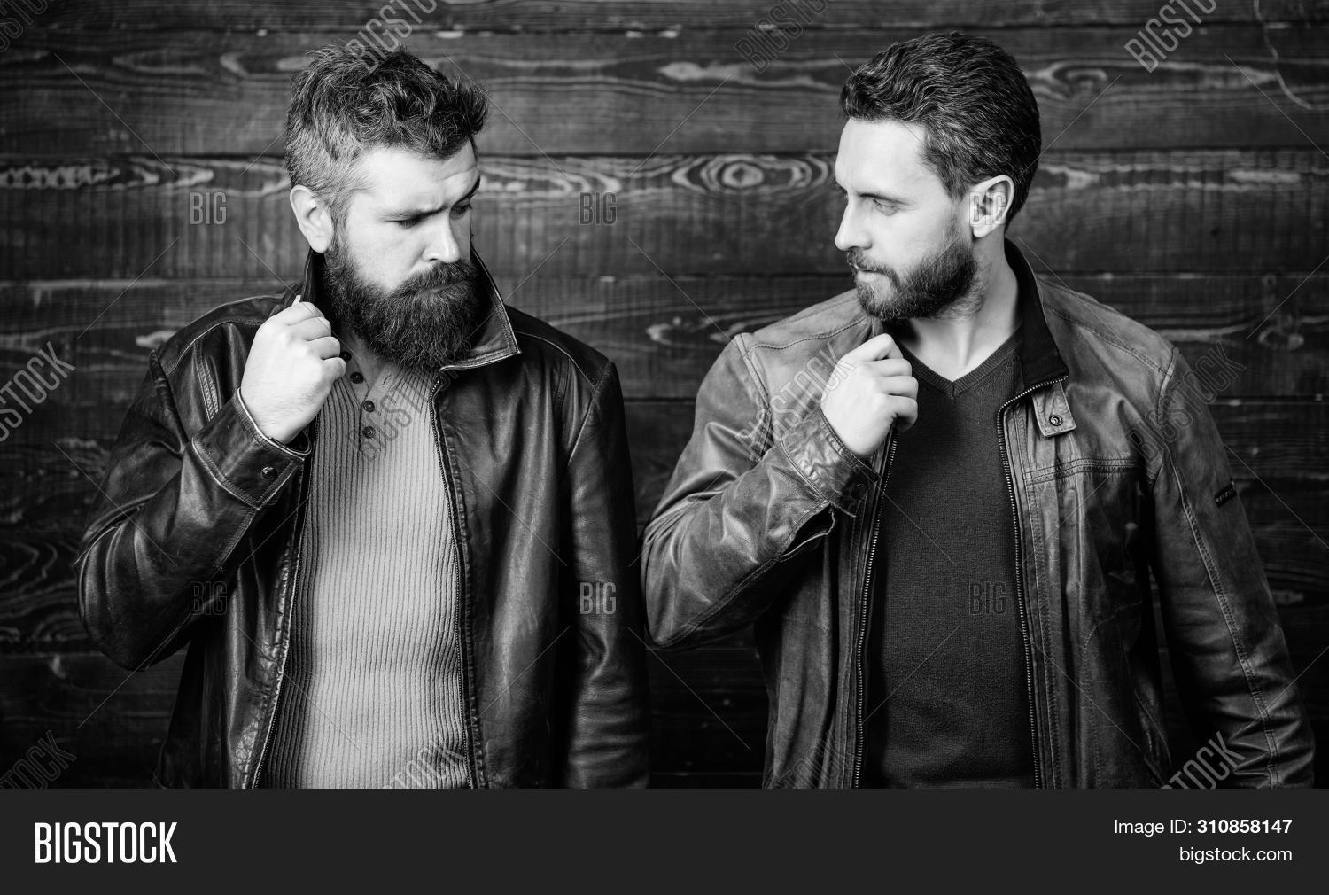 Men Brutal Bearded Hipster Posing In Fashionable Black Leather Jackets. Handsome Stylish And Cool. F