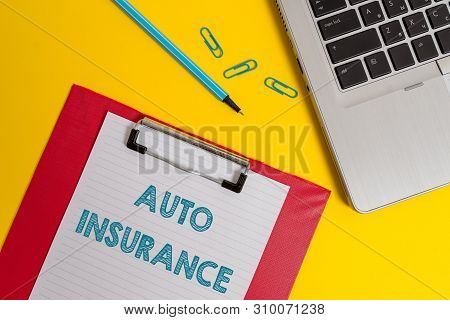 Word writing text Auto Insurance. Business concept for Protection against financial loss in case of accident Open laptop clipboard blank paper sheet marker clips colored background. stock photo