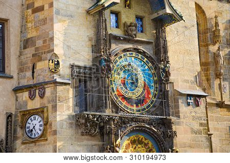 Astronomical clock in Prague, Czech Republic. Famous Orloj on the Old Town Square of the Czech capital. Photographed during morning golden hour. Detail, close up. Beautiful architecture stock photo