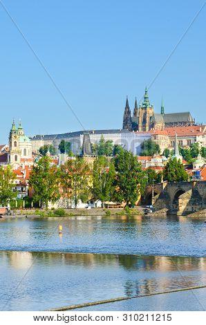Amazing skyline of Prague, Bohemia, Czech Republic with dominant Prague Castle and part of Charles Bridge. The historical old town is located along Vltava River. Praga, Czechia. European cities stock photo