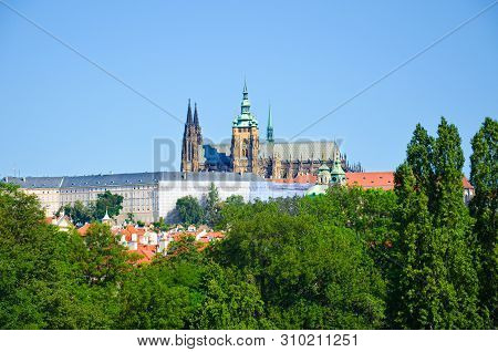 Famous Prague Castle in Prague, Bohemia, Czech Republic surrounded by historical buildings and green trees. Czech capital, Hradcany. St. Vitus Cathedral. Praga, Czechia stock photo