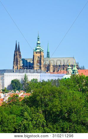 Beautiful Prague Castle with St. Vitus Cathedral, Bohemia, Czech Republic surrounded by historical old town and green trees. Hradcany, Praga, Czechia. European cities stock photo