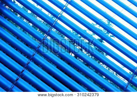Blinds are effective light protection devices made of vertical or horizontal slats. Slats can be fixed or rotated to regulate light and air flow. Blinds are popular in residential, office and industrial premises. stock photo