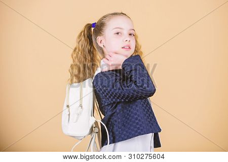 Carry bag comfortable. Stylish mini backpack. Learn how fit backpack correctly. Girl little fashionable cutie carry backpack. Popular useful fashion accessory. Schoolgirl with small leather backpack stock photo