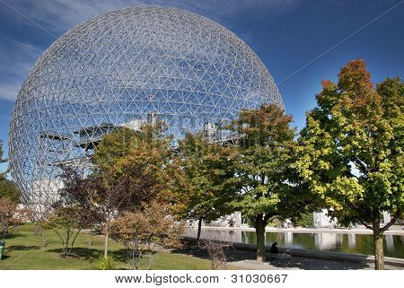 The geodesic dome called Biosphere is a museum in Montreal dedicated to water and the environment. It is located at Parc Jean-Drapeau, on Saint Helen's Island.  The Biosphère is the former pavilion of the United States for the 1967 World Fair Expo 67. stock photo
