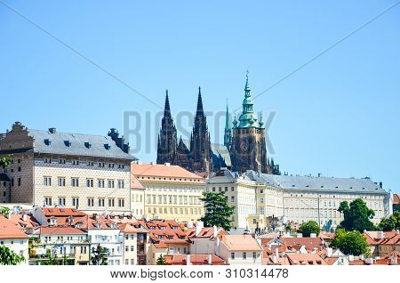 Amazing view of Prague Castle and St. Vitus Cathedral in Prague, Czech Republic photographed on a clear day with historical buildings around the castle. Czech capital, tourist place. Bohemia, Czechia stock photo