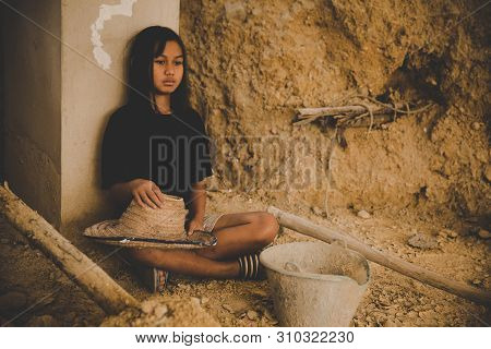 Upset small african american child girl crying covering face with hands sitting alone on floor, sad lonely orphan kid being bullied abused feeling stressed or scared, children violence abuse concept stock photo