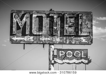 A dilapidated, vintage motel sign in the desert of Arizona stock photo