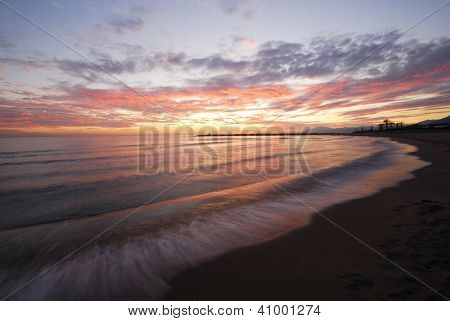 Sunset over the Mediterranean coastline Puerto Cabopino Marbella Costa del Sol Malaga Province Andalusia Spain Western Europe. stock photo