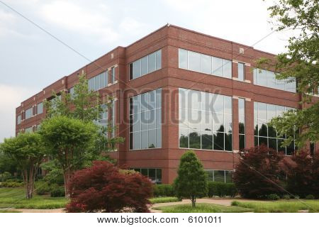 Generic suburban office or medical building with landscaping and footpath. stock photo