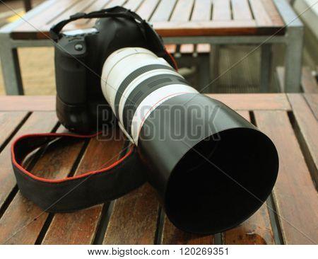 Professional digital photo camera with tele lenses stock photo